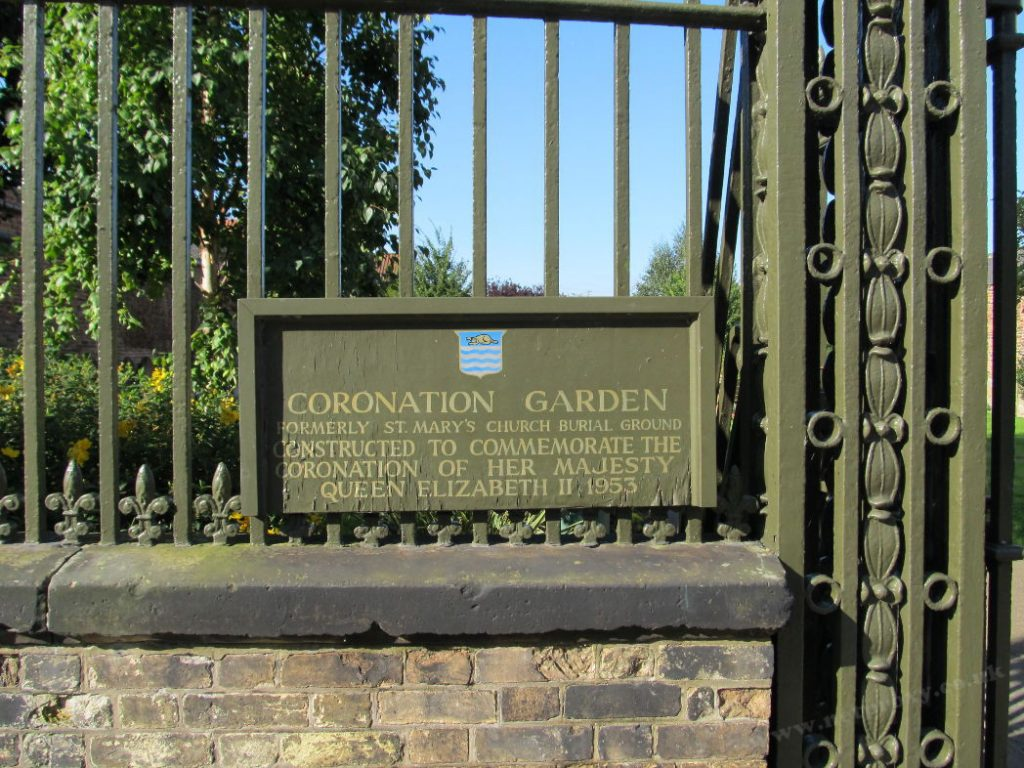 Plaque: Beverley, St Mary's Church burial ground was restructured as The Queen's Coronation Garden.