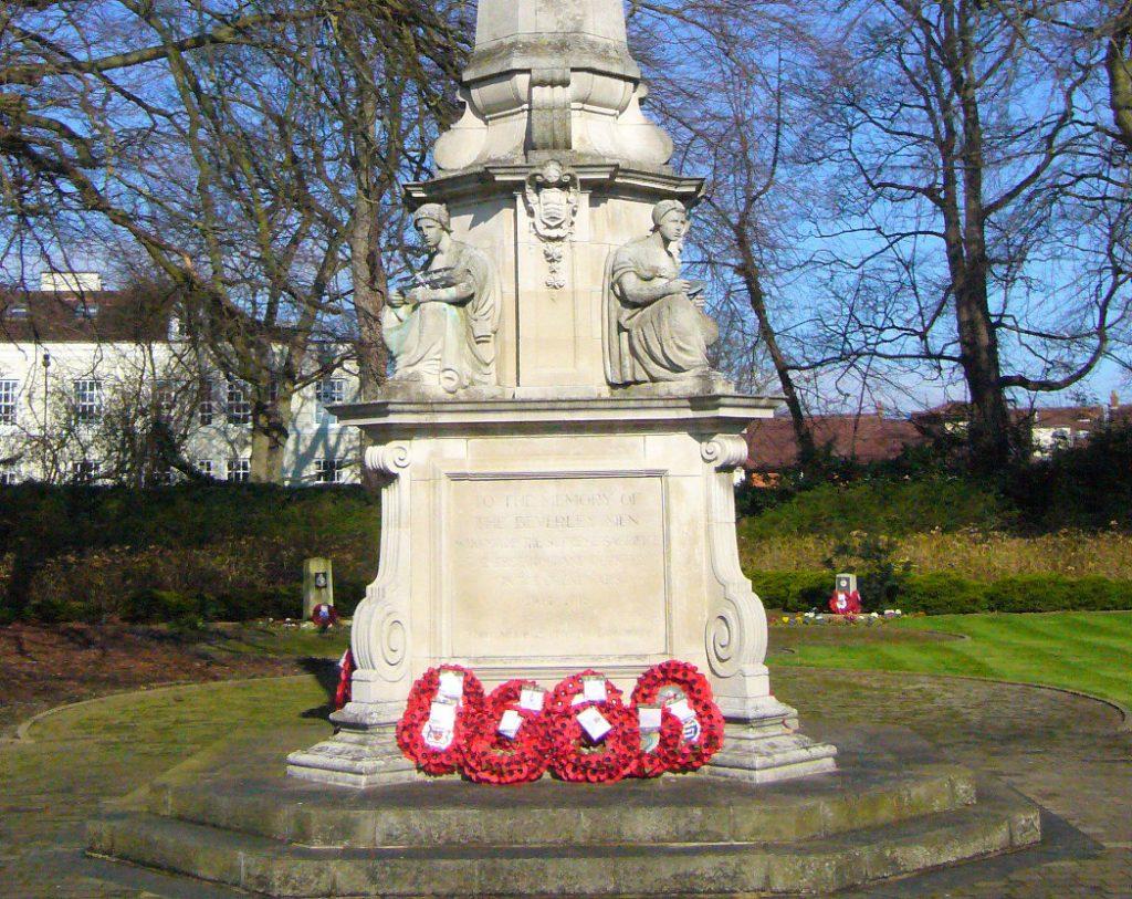 Beverley War Memorial with wreathes in winter